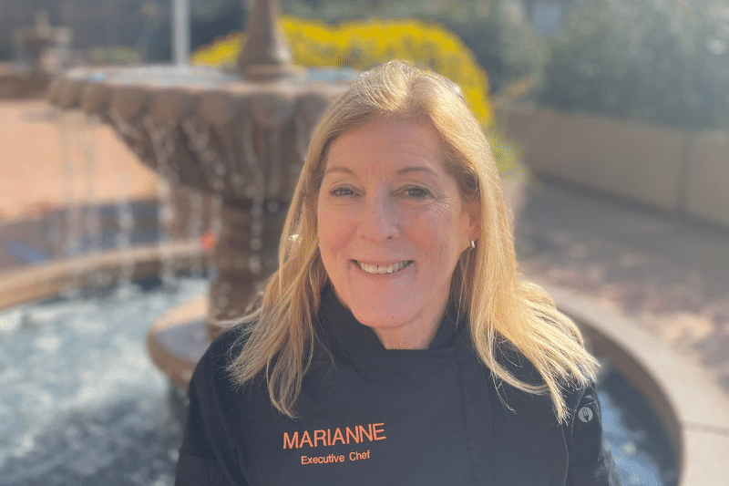 chef Marianne headshot in front of fountain