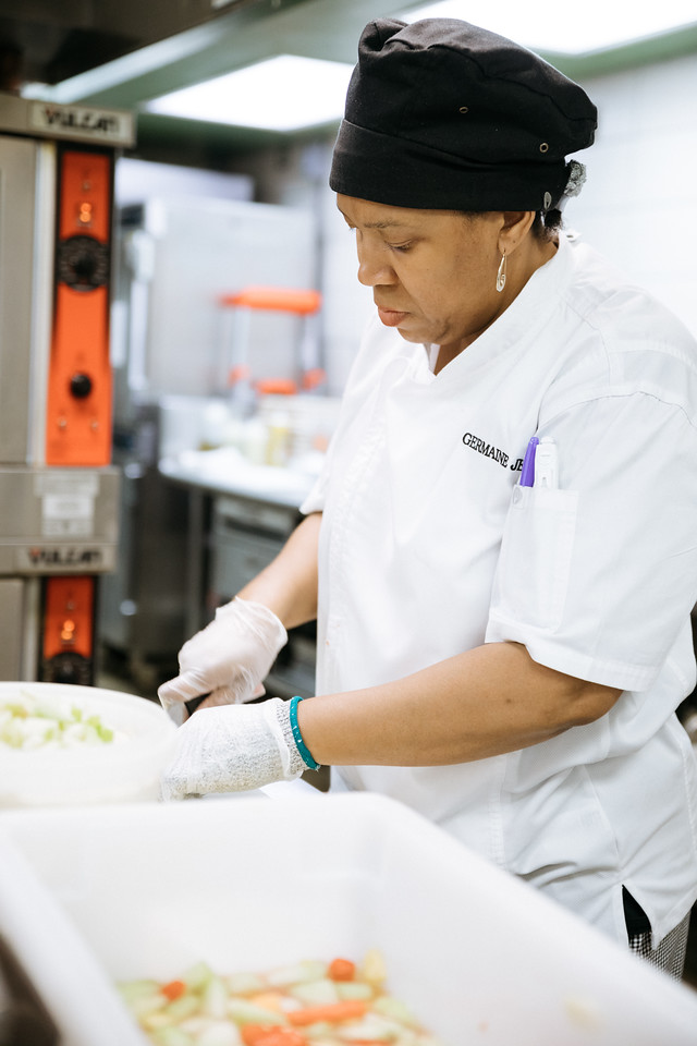 Cook cutting vegetables